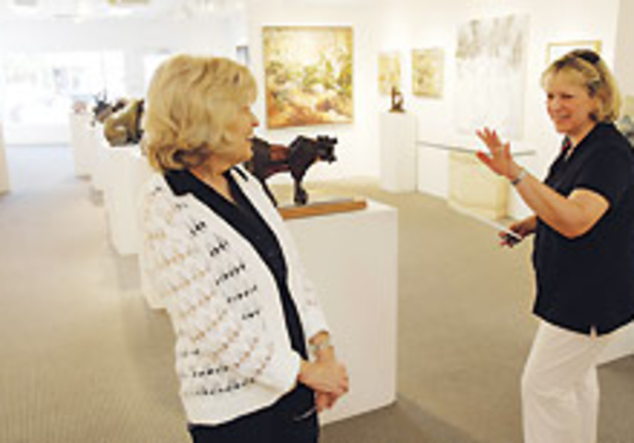 Leslie Levy (left), who has owned an art gallery i
