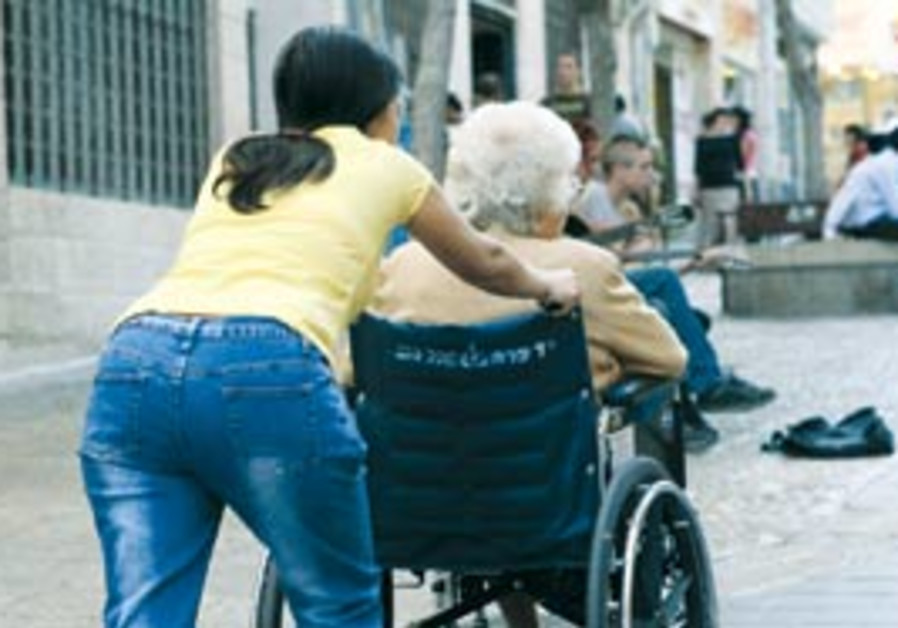 A foreign worker taking care of a senior citizen (