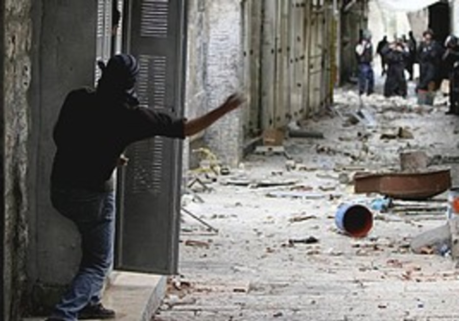 Arab throws stones at police during clashes in J