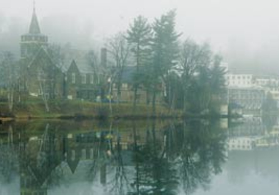 Lake Placid Village is reflected in Mirror Lake (A