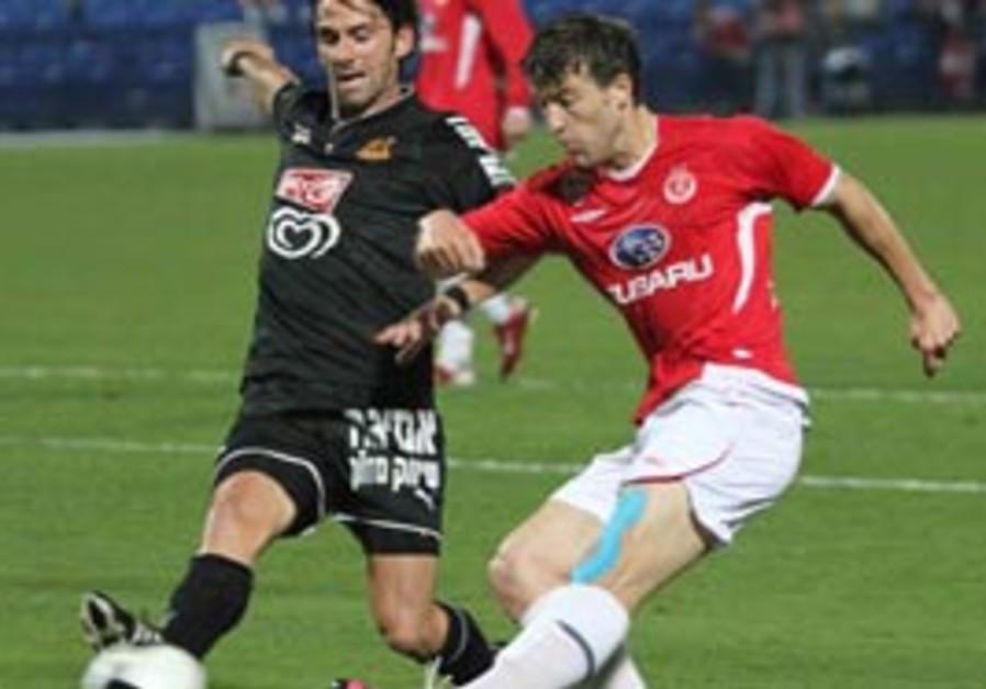 Hapoel Tel Aviv striker Bojan Vrucina puts the bal