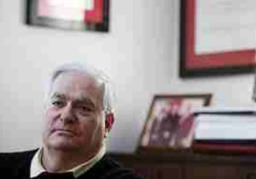 Gary Krupp poses for a picture in his home in Long