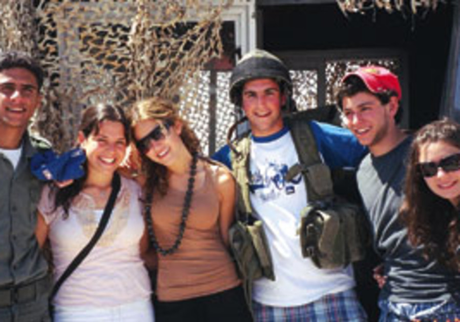 Young filmmakers pose with an IDF soldier.