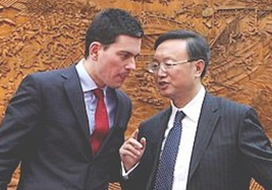 Chinese Foreign Minister Yang Jiechi talks with Br