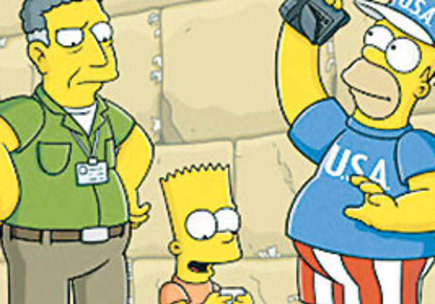 Homer and Bart Simpson visit the Western Wall.
