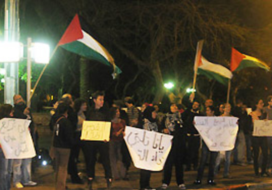 Demonstrators in Jaffa wave anti-Israeli signs and