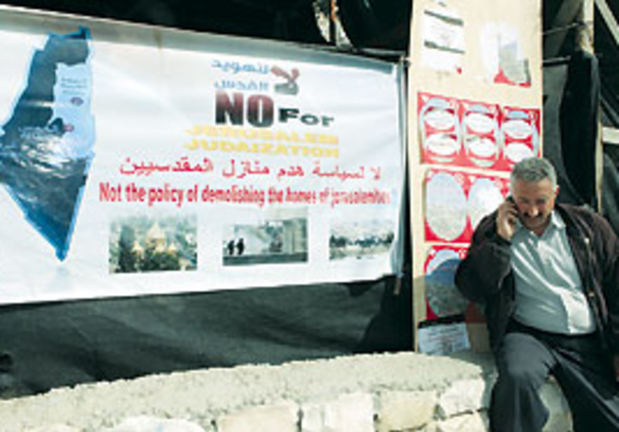 A resident protests plans to build a park in Silwa