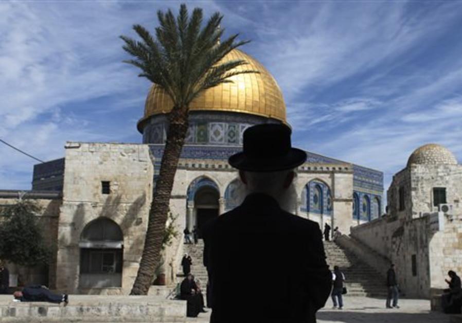 An ultra-Orthodox Jewish man stands in the Al Aksa