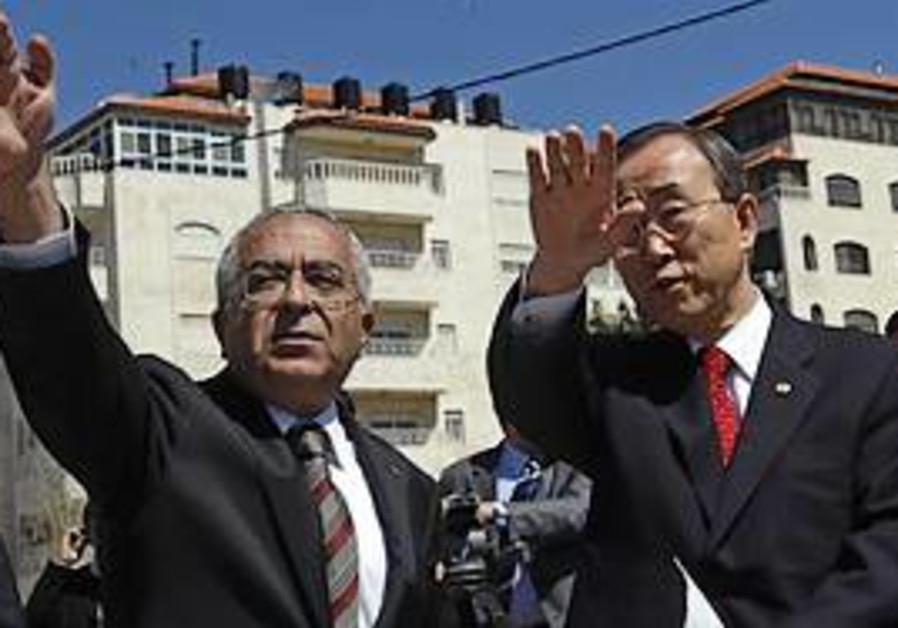 UN Secretary General Ban Ki-moon, left, stands wit