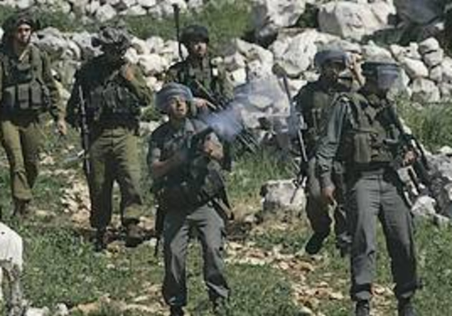 IDF soldiers shoot tear gas canisters at Palestini