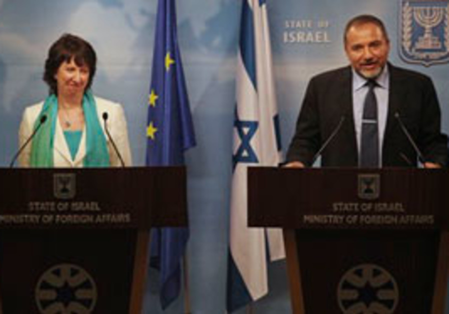 Foreign Minister Avigdor Lieberman, right, talks a