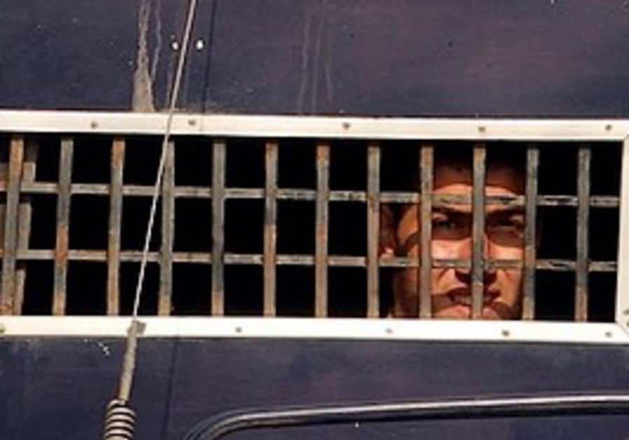 Detained Muslim looks out from prison van.