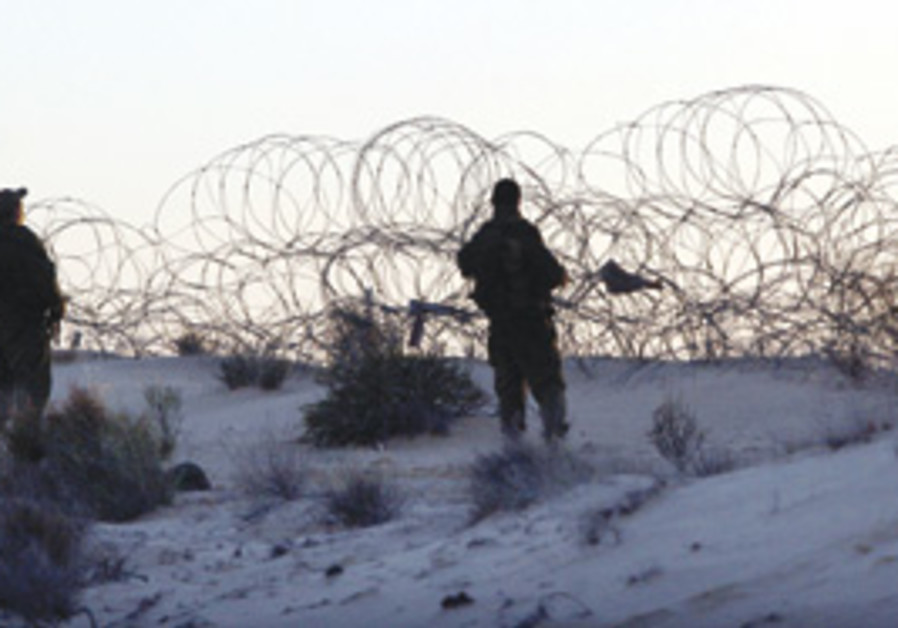 Soldiers stand watch on the Egyptian border.