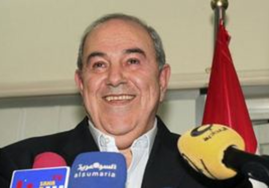 Former Iraqi PM Ayad Allawi speaks to supporters f
