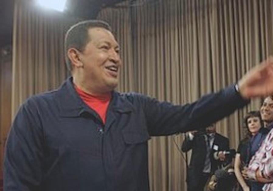 Venezuelan President Hugo Chavez gestures towards