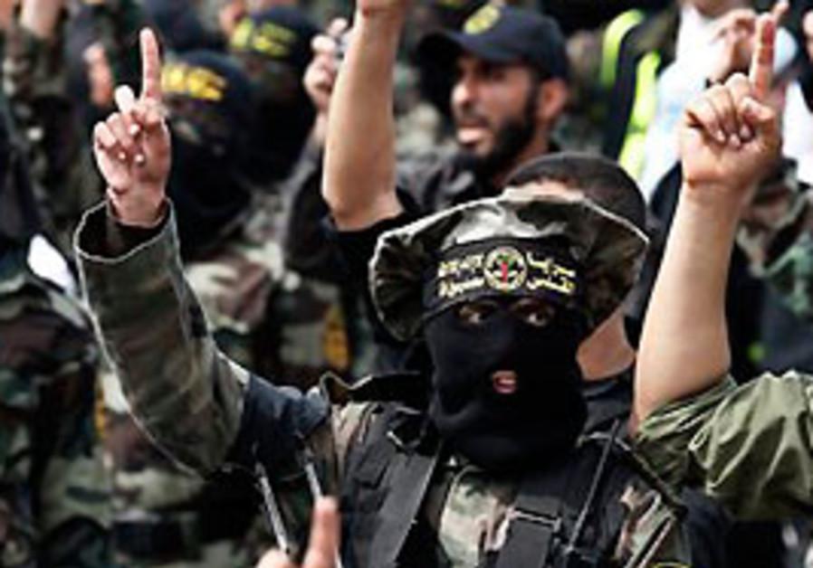 Palestinian Islamic Jihad militants take part in a