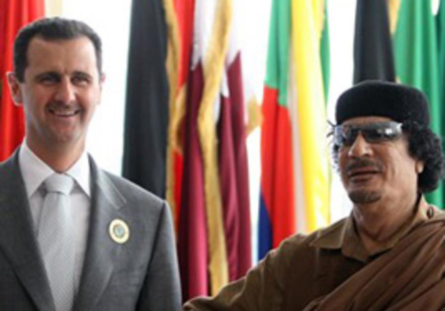 Libyan leader Moammar Gadhafi, right, receives Syr