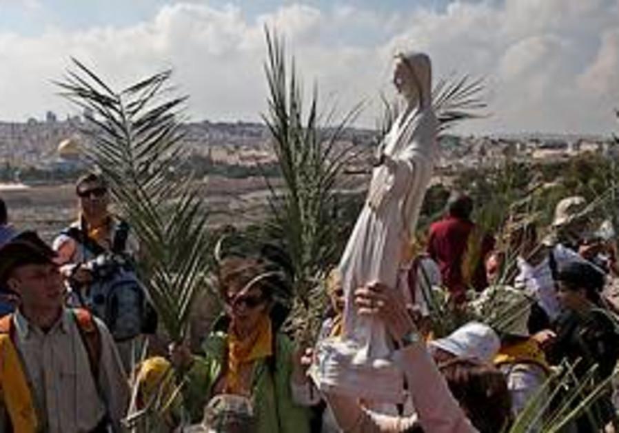 Backdropped by Jerusalem's Old City, Christian wor