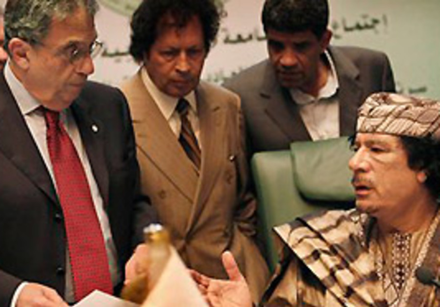 Libyan leader Moammar Gadhafi, right, talks with A