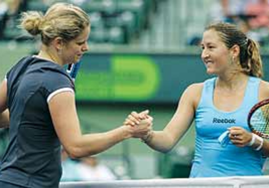 Pe'er and Clijsters shake hands after the match.
