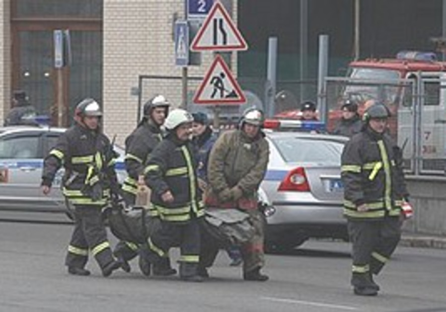 Emergency Ministry officers and firefighters carry