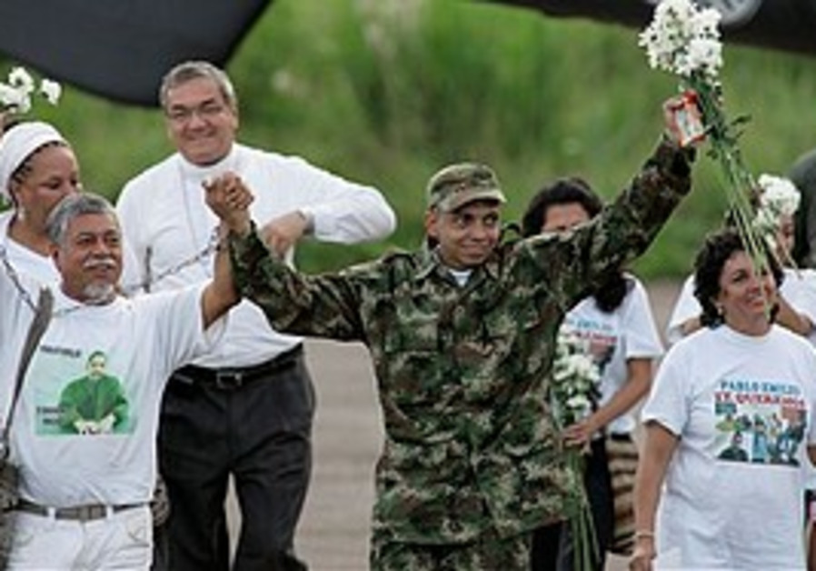 Hostage Pablo Moncayo, center, and his father Gust