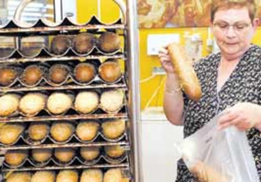 A woman shopping for bread (illustrative - Ariel J