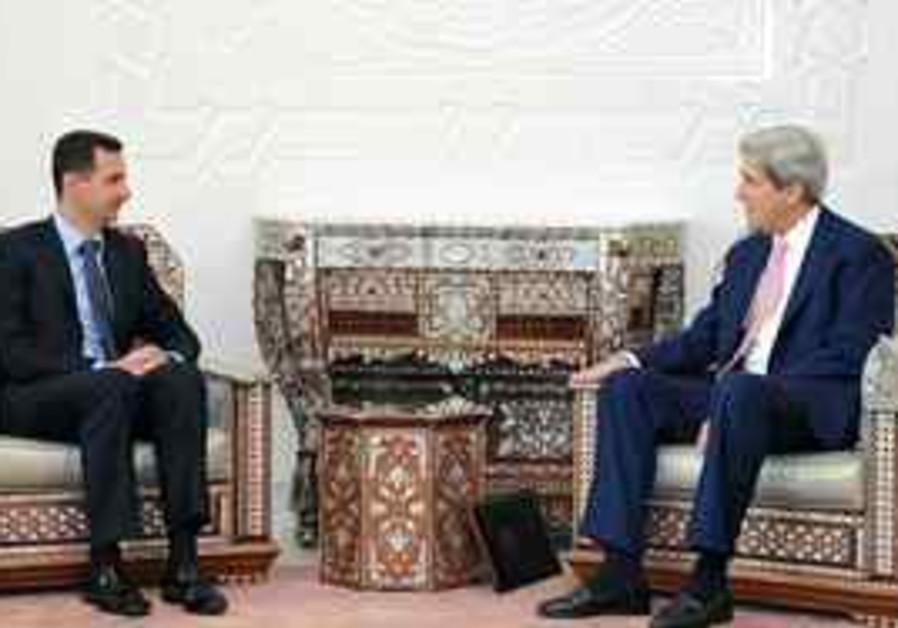 Syrian President Bashar Assad, left, meets with U.