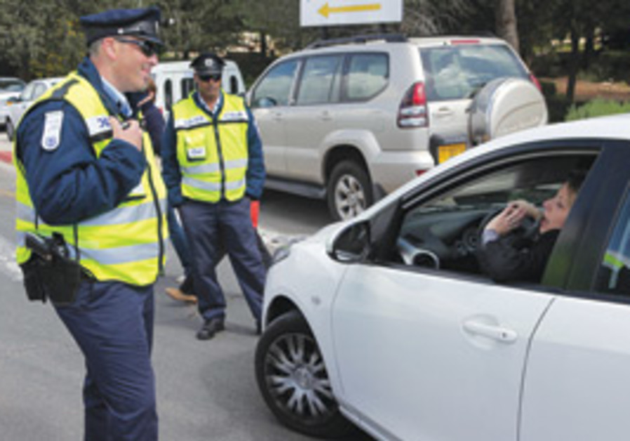 A traffic cop speaks to a driver.