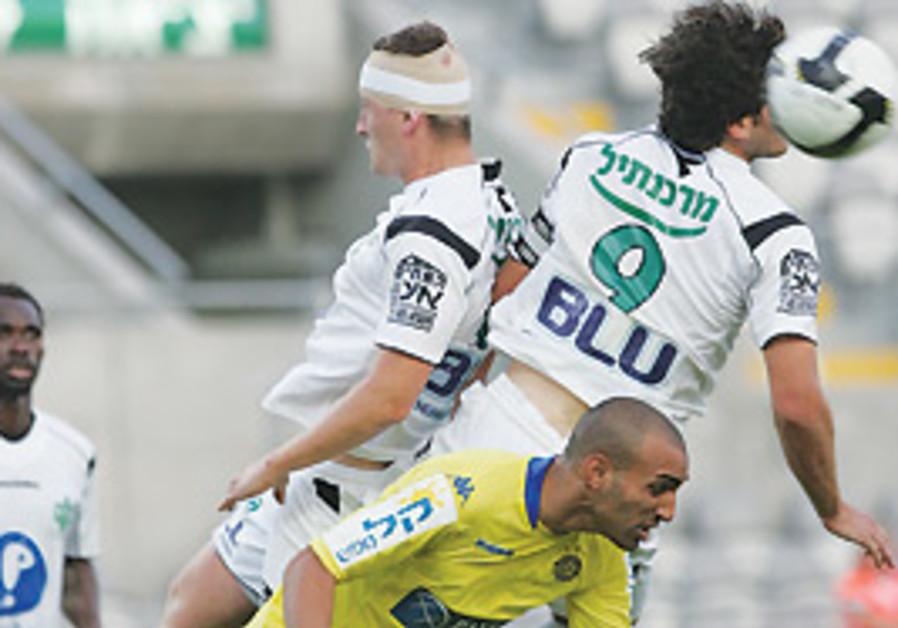 Maccabi Ahi Nazareth's Tomer Hemed (9) rises to he