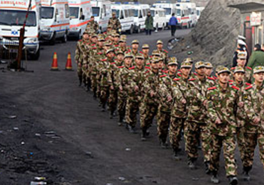 Members of the Chinese paramilitary police march p