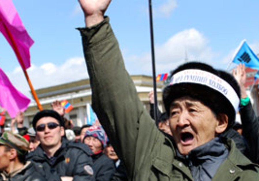 Mongolians take part in a protest against the gove