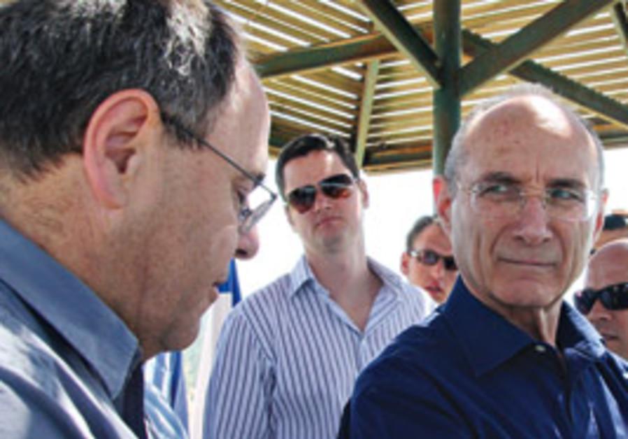 Settler leader Dani Dayan (left) and National Infr