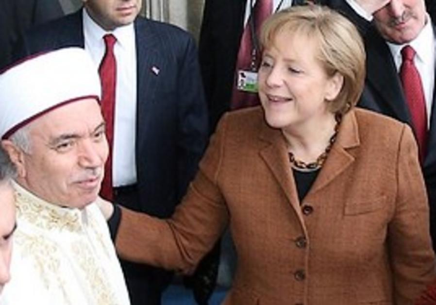 Merkel, right, speaks with Professor Mustafa Cagri