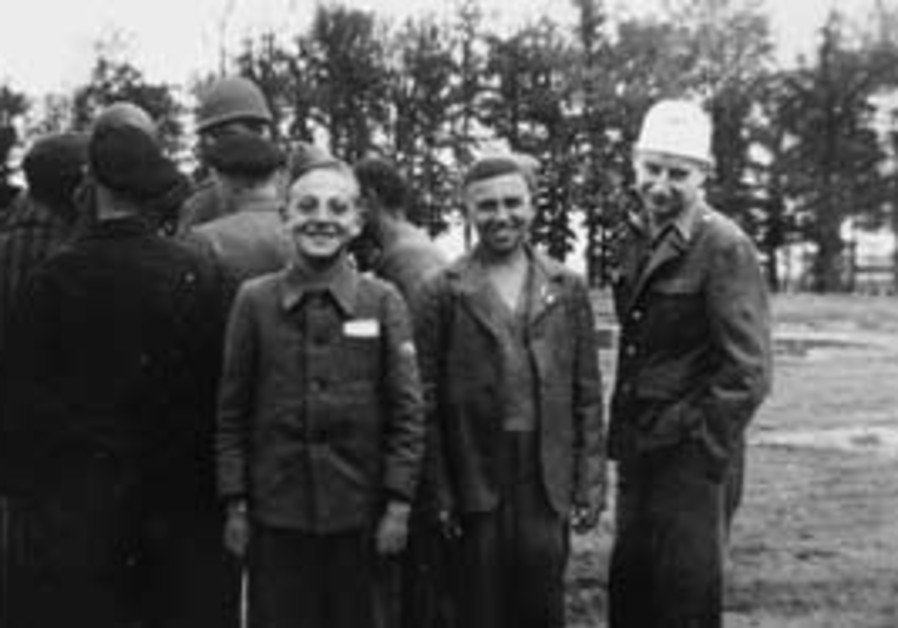 Three young Buchenwald survivors pose smiling for