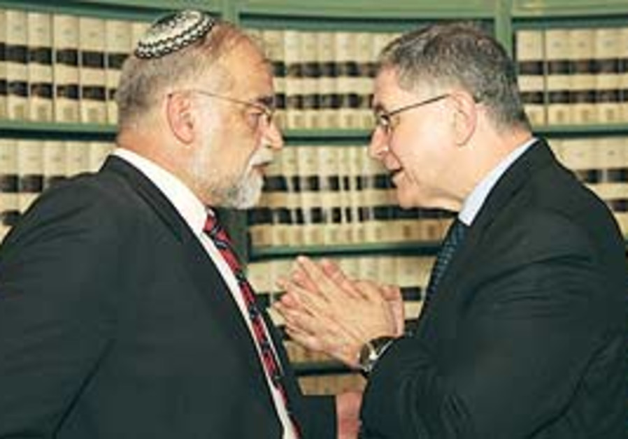 MK David Rotem (left) chats with Rocco Buttiglione