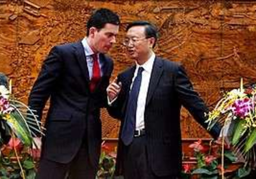 Chinese Foreign Minister Yang Jiechi, right, talks