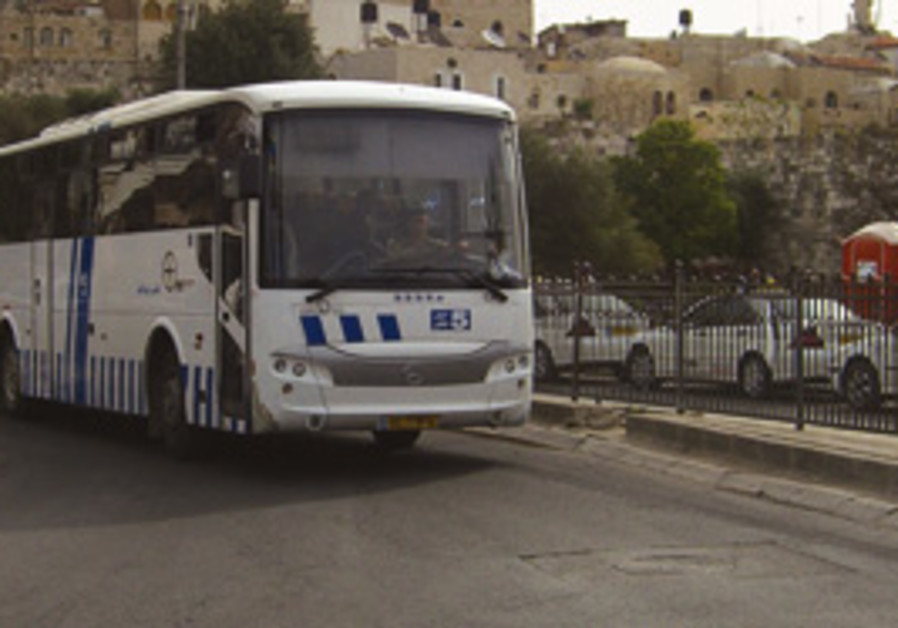 An Arab-run bus driving out of the Old City. Fares