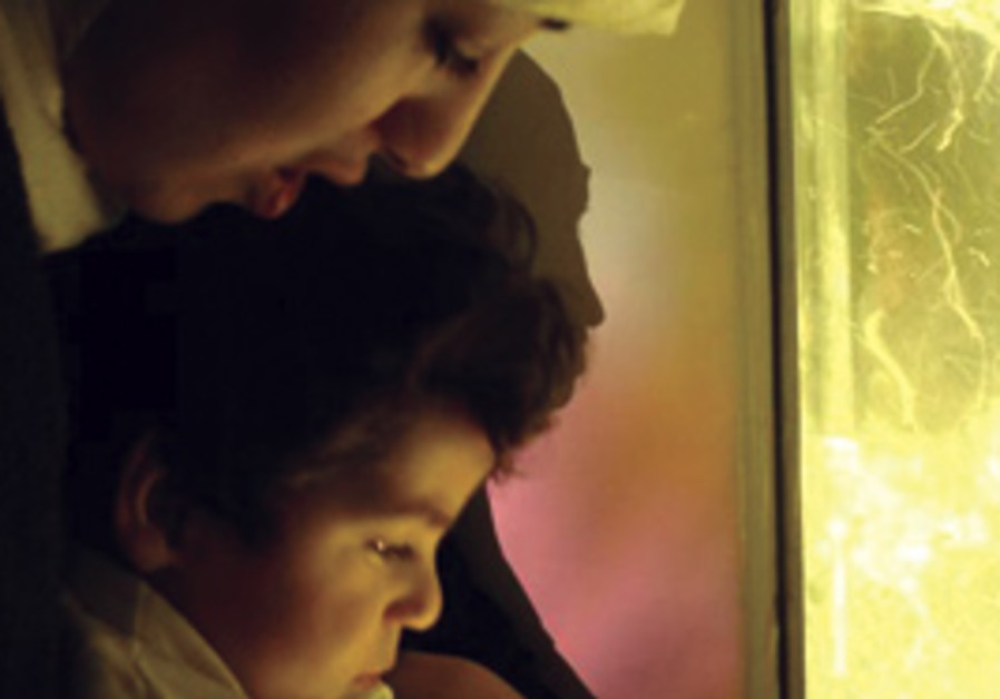 A MOTHER and child use the Snoezelen multi-sensory