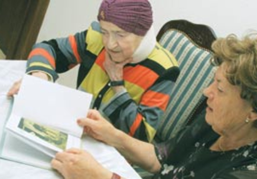 Women examine a memoir from the Life Stories proje