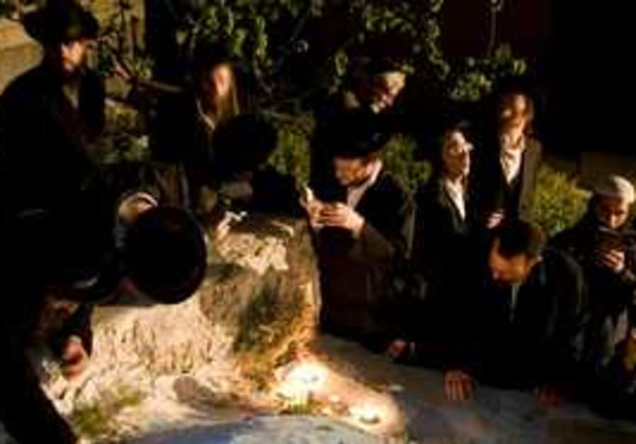 Jewish men pray at the tomb of Biblical figure Nun