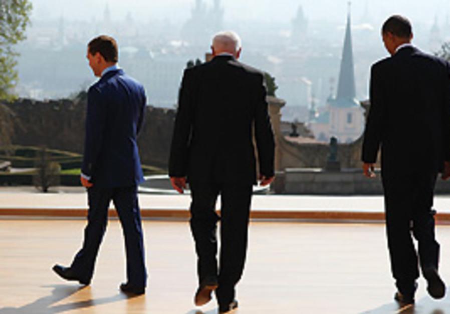 PRESIDENT BARACK OBAMA walks with Russian presiden