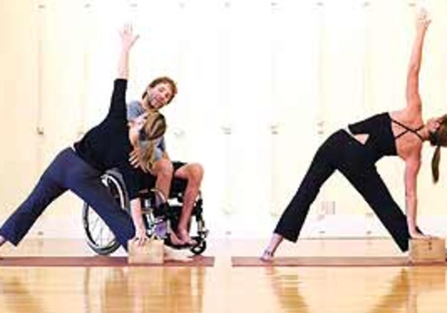 A WHEELCHAIR-BOUND man teaches adaptive yoga. 'Get