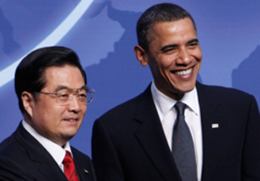 US President Barack Obama greets Chinese President