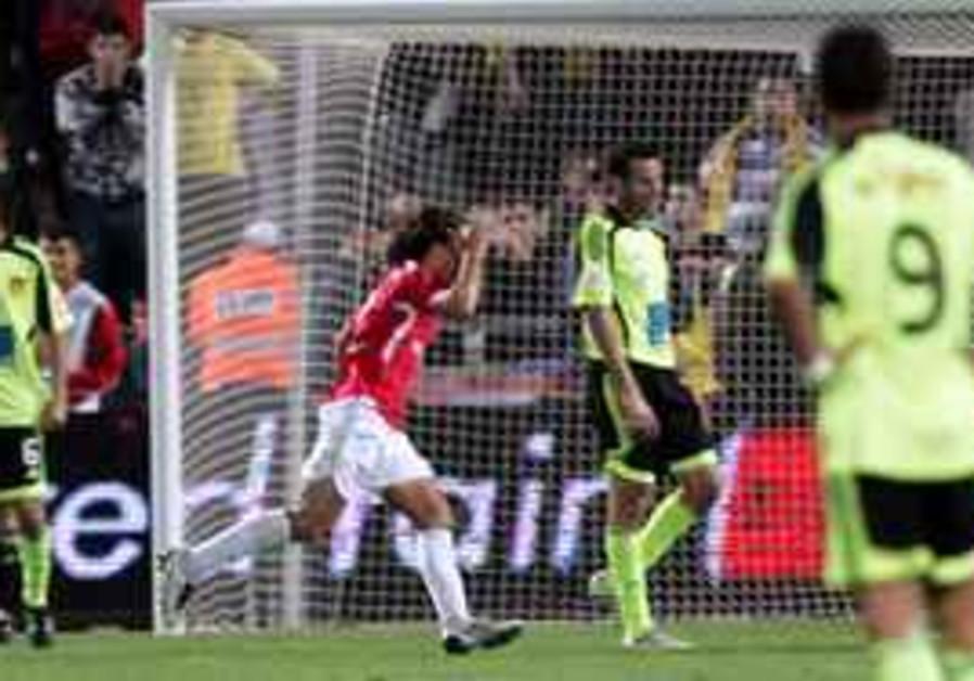 Hapoel Tel Aviv defender Dedi Ben-Dayan celebrates