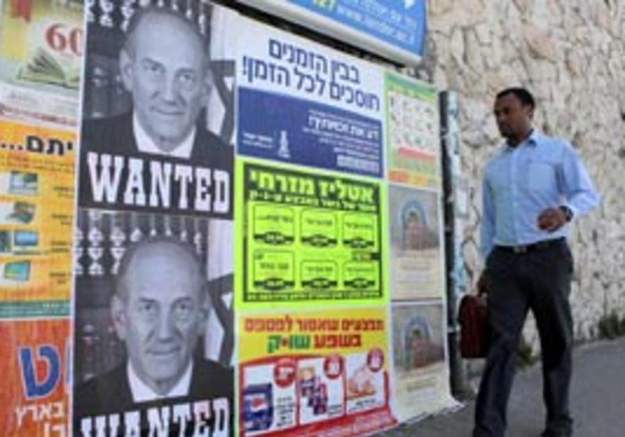 Posters showing former prime minister Ehud Olmert