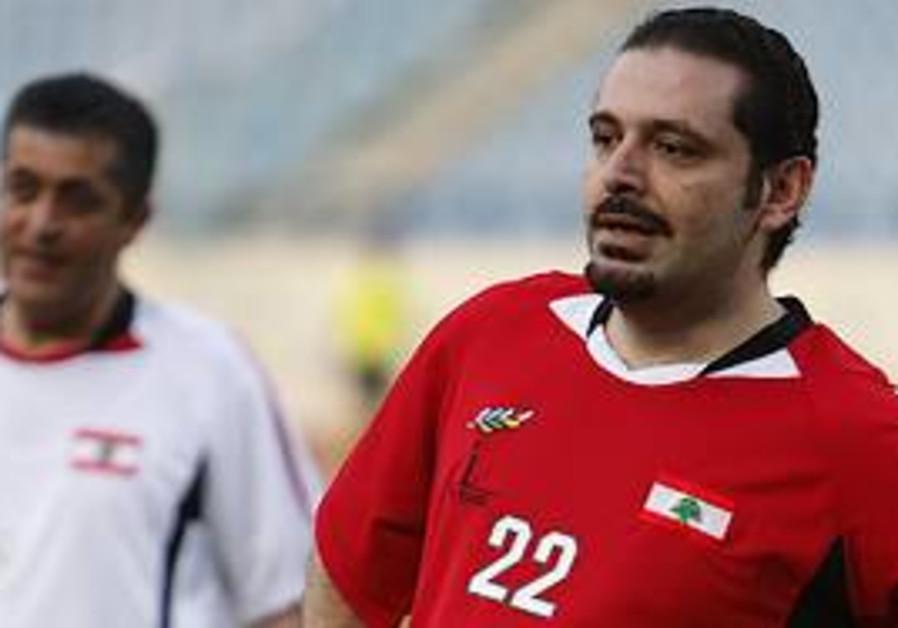 Lebanese Prime Minister Saad Hariri, right, looks