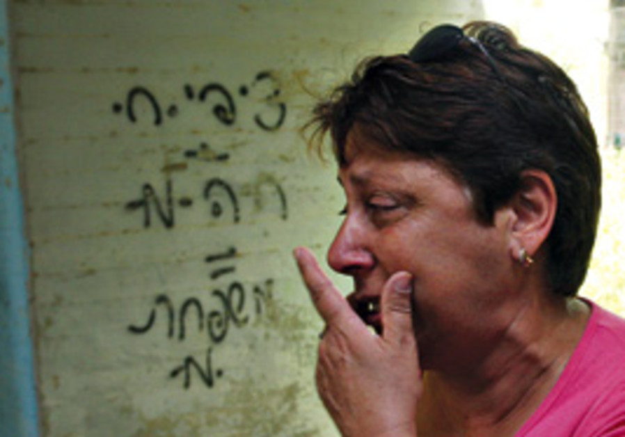 A Sderot woman after a Gazan rocket attack.