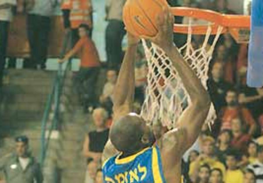 MACCABI TEL AVIV'S Stephane Lasme goes up to the b