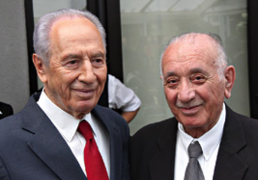 Kamal Mansour with President Shimon Peres.